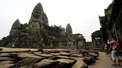 Tourists visit Angkor Wat Temple Stock Footage