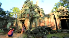 Tourists visit Ta Prohm Temple Stock Footage