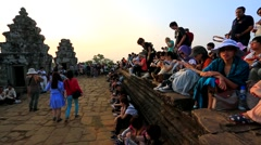 Tourists enjoy beautiful scenery during sunset hours at Phnom Bakheng temple Stock Footage