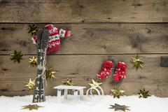 Christmas wooden background with a skiing concept for traveling. Stock Photos