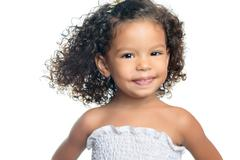 Cute ethnic little girl with an afro hairstyle Stock Photos