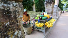 Local woman sells fruits for tourists Stock Footage