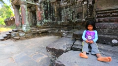 Cambodian girl at Preah Khan temple Stock Footage
