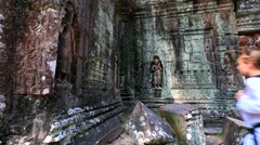 Young woman backpacker visiting Ta Som temple. Stock Footage