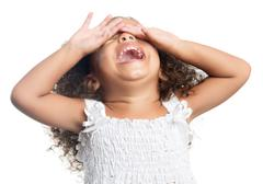 little girl with an afro hairstyle laughing - stock photo
