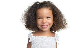 Little girl with an afro hairstyle smiling Stock Photos