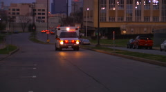Ambulance Drive-by at Night with Flashing Lights and Sirens Stock Footage
