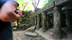 Young male backpacker visiting Beng Melea temple. Stock Footage