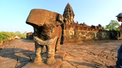 Young male backpacker visiting Bakong temple Stock Footage