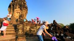 Tourists visit Bakong temple. Stock Footage