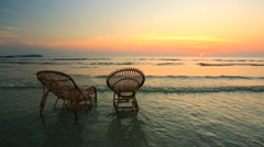 Two empty wooden chairs standing in a water. Stock Footage