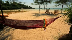 Beautiful hammock on the tropical beach - stock footage