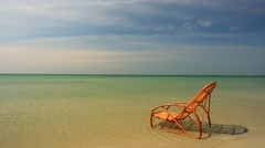 Lounge chair on a beach Stock Footage