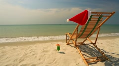 Sunlounger with Santa hat and coctail Stock Footage