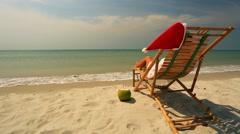 Woman sunbathing on a sunlounger Stock Footage