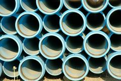 stack of blue pipes - stock photo
