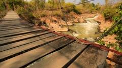 Hinged bridge on the Mekong River. Stock Footage