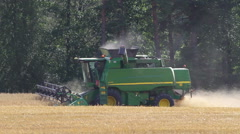 Farmer driving with combine harvester Stock Footage