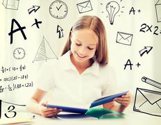 student girl studying at school - stock illustration