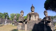Backpacker visiting Buddha Park Stock Footage