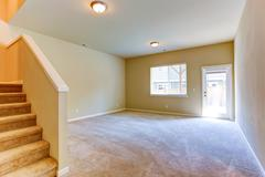 living room with walkout deck. empty house interior - stock photo