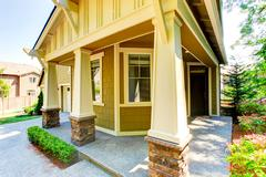 walkout basement porch with columns - stock photo