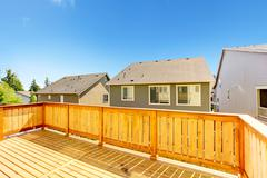 Walkout deck  with wooden railing Stock Photos