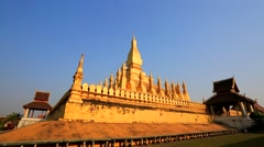 Backpacker visiting Wat Pha That Luang Stock Footage