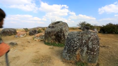 Backpacker visiting plain of Jars Stock Footage