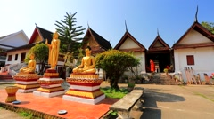 Monks at Wat Mai Suwannaphumaham Stock Footage