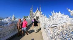 Tourists visit Wat Rong Khun temple Stock Footage