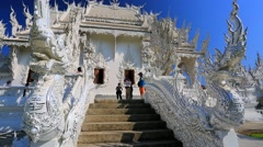 Tourists visit Wat Rong Khun temple Stock Footage