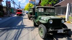 Vintage military jeep on a street. Stock Footage