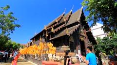 Tourists visit Wat Phan Tao temple. Stock Footage