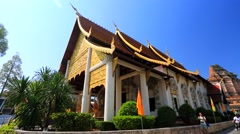 Tourists visit Wat Chedi Luang temple. - stock footage