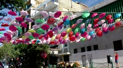 Western Asia Red Sea Jordan Aqaba 015 colorful umbrellas hang above the street Stock Footage