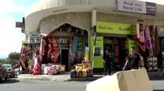 Western Asia Red Sea Jordan Aqaba 020 shop with scarves and bags at a corner Stock Footage