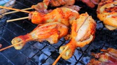 Close up shot of grilling chicken legs Stock Footage