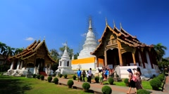 Tourists visit Wat Phra Singh temple. - stock footage