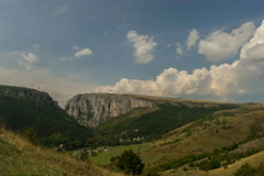 Cumulus clouds rising above canyon in summer, Turzii Gorge 6K Stock Footage