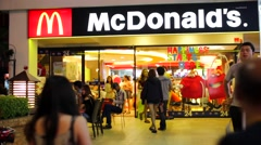 People visit Mcdonalds restaurant Stock Footage