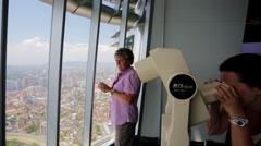 Binoculars at the top of Petronas towers Stock Footage