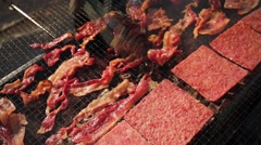 Bacon cooking on a griddle Stock Footage