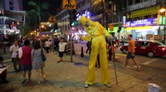 Stilt walker at evening street. Stock Footage