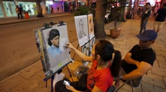 Street artist draw pictures for tourists. Stock Footage