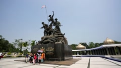 Tourists visit Malaysia's National Monument Stock Footage