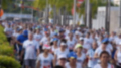 Crowd of marathon runners off focus Stock Footage