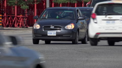 Close-Up of Automobile traffic through an Intersection Stock Footage
