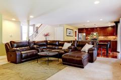 house interior. living room with cozy leather couch - stock photo