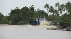Tidal river bore wave breaking along the banks of the Kampar River Stock Footage